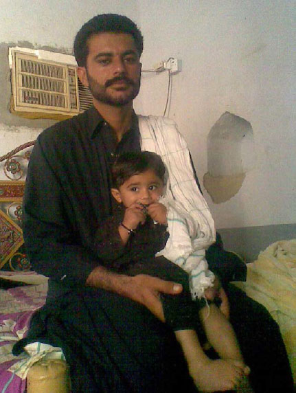 ANOTHER VICTIM? Asim Faqir, here with his son Gwahram, was the victim of an extra-judicial killing by Pakistani security forces in May, his family say. Pakistan's military did not respond to a request for comment. REUTERS/FAMILY/ HANDOUT