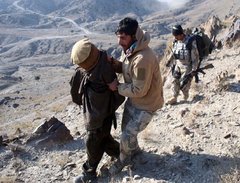TACKLING THE TALIBAN: the United States is turning over the battle against the Taliban insurgency to Afghan forces as it focuses on shutting down the source of its funding. REUTERS/Goran Tomasevic